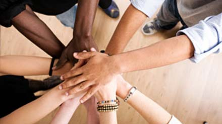 Photo of a group of peoples hands